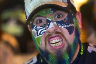David Macias-Clark of Henderson shows his Seahawk loyalty as he watches the Super Bowl at Scooter's Pub, 6200 South Rainbow Blvd., Sunday, Feb.1, 2015.