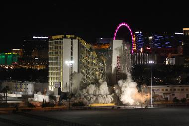 The Clarion Hotel and Casino is imploded in the early morning hours Tuesday, Feb. 10, 2015. The hotel, opened in 1970, was once owned by actress Debbie Reynolds and named the Debbie Reynolds Hollywood Hotel. A mixed-use resort, catering to convention-goers, is planned for the site, according to developer Lorenzo Doumani.