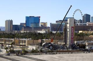 The remains of the Clarion Hotel and Casino, with elevator tower still standing, are shown after the building was imploded Tuesday, Feb. 10, 2015. The hotel, opened in 1970, was once owned by actress Debbie Reynolds and named the Debbie Reynolds Hollywood Hotel. A mixed-use resort, catering to convention-goers, is planned for the site, according to developer Lorenzo Doumani.