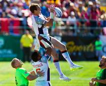 United States player is hoisted high for a catch versus South Africa during the USA Sevens International Rugby Tournament at Sam Boyd Stadium on Saturday, ...