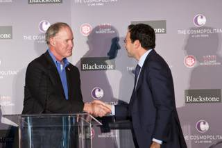 D. Taylor, President of UNITE HERE, shakes hands with Jonathan Gray, of Blackstone, during an event celebrating The Cosmopolitan of Las Vegas' new ownership by Blackstone, Wed. Feb 18, 2015.