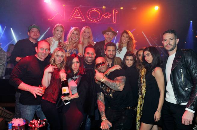 Scott Disick, fifth from right — with Kourtney Kardashian, fourth from right, and friends — hosts at 1 OAK on Saturday, Feb. 21, 2015, in the Mirage.