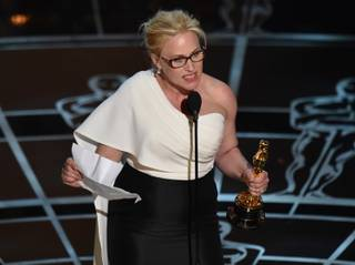 "Patricia Arquette accepts the Academy Award for Best Actress in a Supporting Role for ""Boyhood"" during the Oscars on Sunday, Feb. 22, 2015, at the Dolby Theater in Los Angeles."
