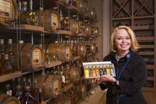 Owner Kim Weiss poses in VOM FASS at the Grand Canal Shoppes in the Venetian Tuesday, Feb. 24, 2015. The store sells whiskeys and liqueurs on tap and lets shoppers sample them before purchasing. The company also sells wine, specialty oils and vinegars.