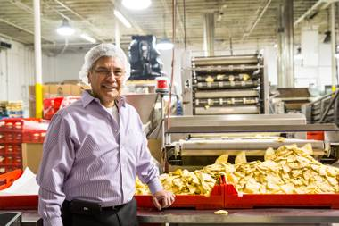 Owner Gus Gutierrez stands amidst the production lines of chips and tortillas begin made in his family-owned tortilla factory Tortillas Incorporated in North Las Vegas January 22, 2015.