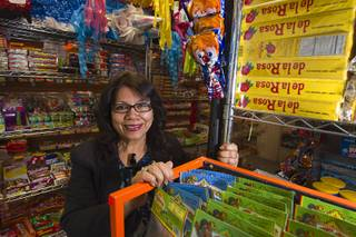 Owner Christy Delcid poses in Christy's Candy Shop at the Boulevard Mall Sunday, March 1, 2015.