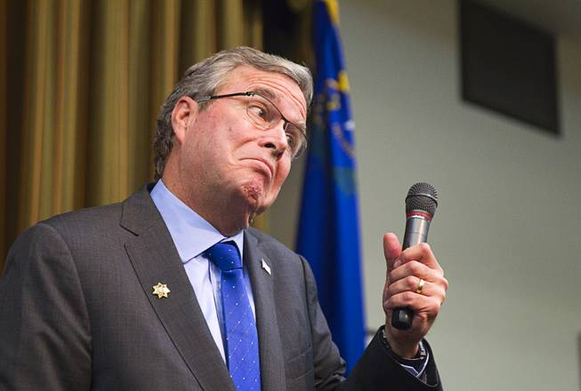 Former Florida Gov. Jeb Bush reacts to a question at the Mountain Shadows Community Center in Las Vegas Monday, March 2, 2015.