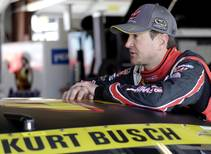 In this Sept. 13, 2014, file photo, Kurt Busch talks to his crew in the garage during practice for a NASCAR Sprint Cup series auto ...