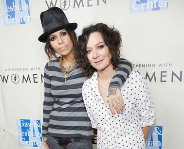 "In this March 15, 2014 file photo, Linda Perry, left, and Sara Gilbert arrive at L.A. Gay and Lesbian Center ""An Evening with Women"" Kick Off Concert Event in West Hollywood, Calif. Gilbert shared the news of her new baby on ""The Talk."" Co-host Julie Chen announced on the Monday, March 2, 2015, episode that Gilbert welcomed a son, Rhodes Emilio Gilbert Perry, over the weekend, her first with wife, Perry."