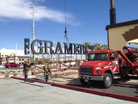 Workers with Nevada Sign prepare to hoist part of a 90-foot sign at the Gramercy mixed-use development Tuesday, March 3, 2015.