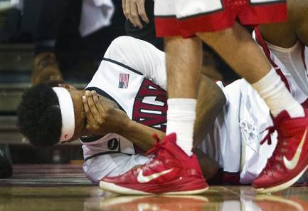 UNLV guard Patrick McCaw lies on the court with concussion-like symptoms after taking a hard shot against San Diego State at the Thomas & Mack Center, Wednesday, March 4, 2015.
