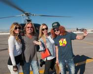 Vince Neil, Carrot Top and guests attend the Kobalt 400 via Maverick Helicopter on Sunday, March 8, 2015, at Las Vegas Motor Speedway.