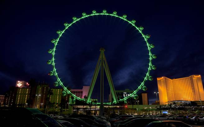 The High Roller at the Linq Promenade is lit green for St. Patrick's Day on Monday, March 16, 2015, in Las Vegas.