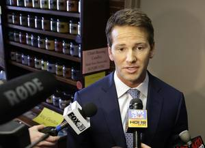 In this Feb. 6, 2015, file photo, Rep. Aaron Schock, R-Ill. speaks to reporters in Peoria, Ill. Schock announced Tuesday his resignation amid questions about spending.