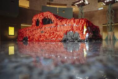 """La Sangre Nunca Muere"" by Justin Favela and Sean Slattery is seen on display at the Clark County Government Center Monday, March 16, 2015 for their exhibit ""Car Show""."