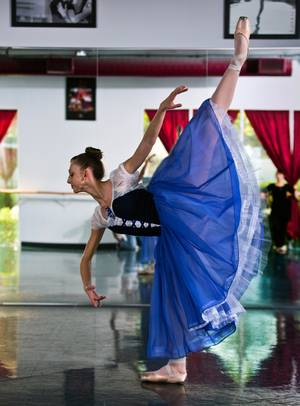 Ballerina Monika Haczkiewicz, 17, arches over while in dance class inside the Keith Kleven Institute on Wednesday, March, 25, 2015. She's going to New York City in April with instructor Tara Foy to compete for a chance to attend a prestigious dance school or join a ballet company.