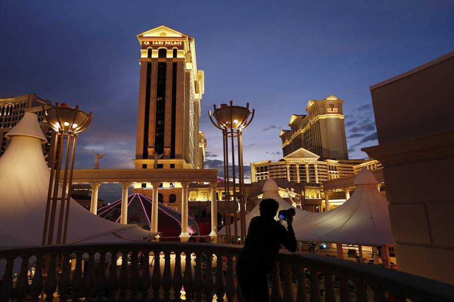 A man takes pictures of Caesars Palace in Las Vegas, Jan. 12, 2015.