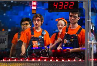 Team Clockwork Oranges of Orange, Calif., control their robot in the arena during a match at the FIRST Robotics Competition at the Cashman Center on Friday, March, 27, 2015.