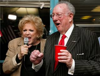 Mayor Carolyn Goodman, with husband former Mayor Oscar Goodman, excitedly announces her win and celebrates on election night Tuesday, April 7, 2015, during a party at her headquarters.