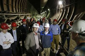 People stand inside of Yucca Mountain during a congressional tour Thursday, April 9, 2015, near Mercury, Nev. Several members of congress toured the proposed radioactive wast dump 90 miles northwest of Las Vegas. (AP Photo/John Locher)