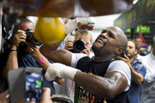 WBC/WBA welterweight champion Floyd Mayweather Jr. hits a speed bag at the Mayweather Boxing Club Tuesday, April 14, 2015. Mayweather will face WBO welterweight champion Manny Pacquiao of the Philippines in a unification bout at the MGM Grand Garden Arena on May 2.  .