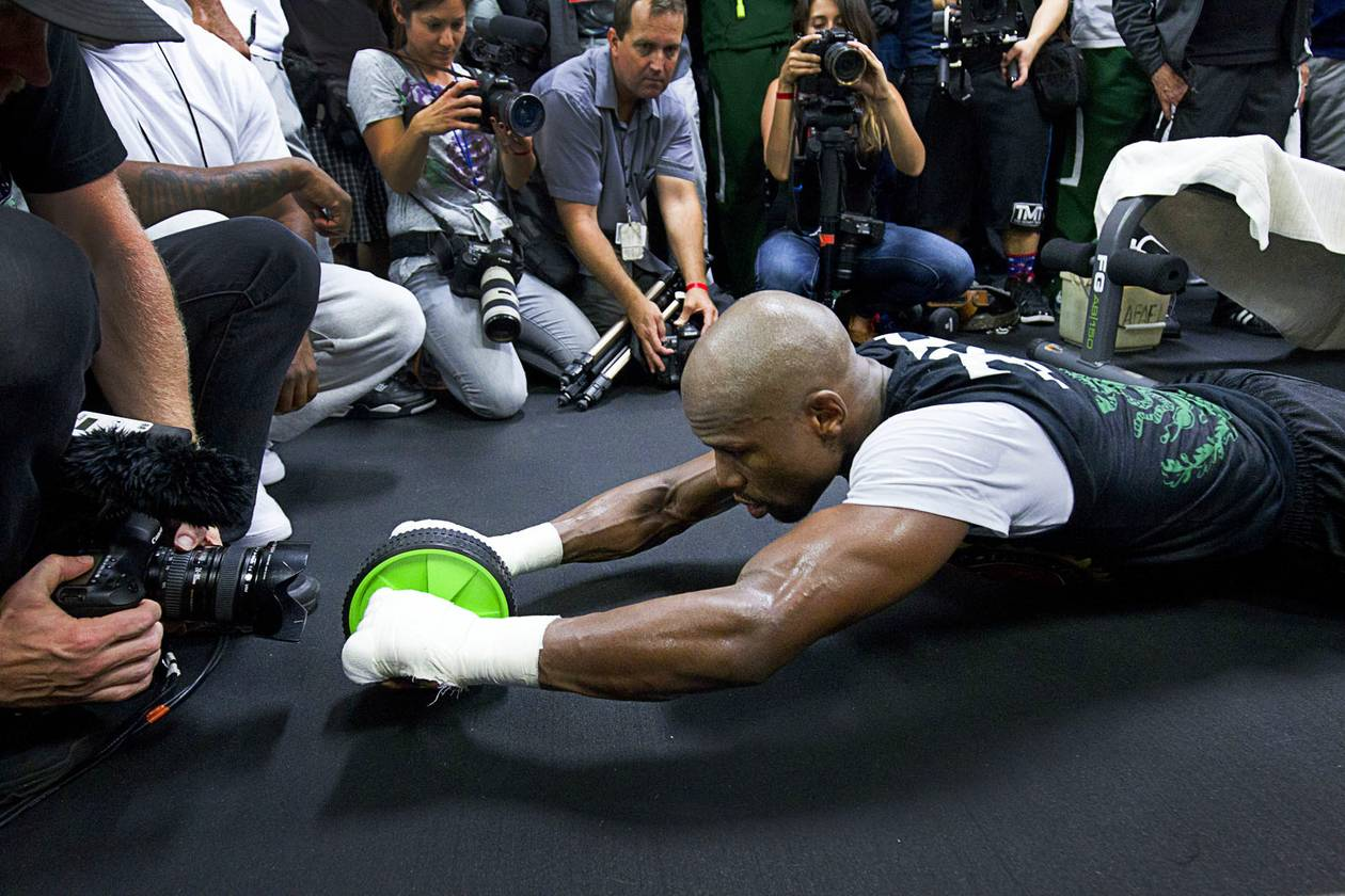 Floyd Mayweather Jr. is a gym rat. His workouts are sometimes so long that I get tired just photographing him.