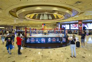 People take photos of a boxing ring in the MGM Grand Monday, April 20, 2015. Floyd Mayweather Jr. and Manny Pacquiao will fight at the MGM Grand Garden Arena on Saturday, May 2.  ..