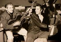 Liberace and Elvis Presley trade jackets and instruments in an impromptu jam session Nov. 14, 1956, at the Riviera.