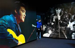 Classic Elvis photos greet visitors now hanging within Gracelands first-ever permanent exhibition outside of Memphis and in the Westgate Resorts on Thursday, April 23, 2015.