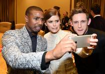 Actors Michael B. Jordan, Kate Mara and Jamie Bell take a selfie during Day 3 of CinemaCon, the official convention of the National Association of Theater Owners, on Wednesday, April 22, 2015, at Caesars Palace.
