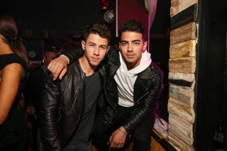 Nick Jonas, left and with brother Joe Jonas, celebrates the third anniversary of Hyde Bellagio on Saturday, April 25, 2015, in Las Vegas.
