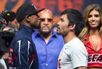 Undefeated WBC/WBA welterweight champion Floyd Mayweather Jr., left, and WBO welterweight champion Manny Pacquiao of the Philippines face off during an official weigh-in at the ...