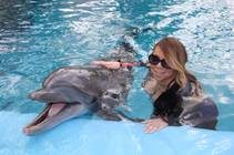 Mariah Carey and bottlenose dolphin Osborne at Siegfried & Roy's Secret Garden and Dolphin Habitat on Thursday, April 30, 2015, at the Mirage.
