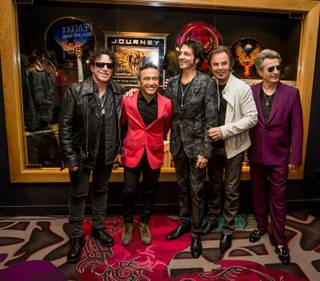 Neal Schon and Journey memorabilia cases are unveiled Wednesday, May 6, 2015, at the Hard Rock Hotel.