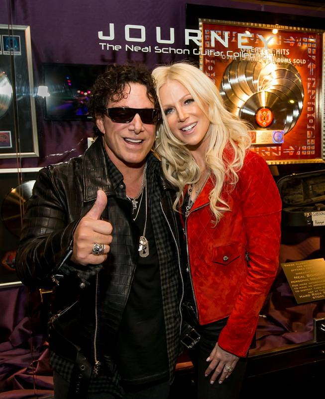 Neal Schon and Journey memorabilia cases are unveiled Wednesday, May 6, 2015, at the Hard Rock Hotel. Schon is pictured here with wife Michaele.