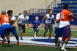 Thaddeus Thatcher, 7, carries the ball for a touchdown during practice Wednesday, May 13, 2015, at Bishop Gorman High School. Thatcher, who has been diagnosed with leukemia, became an honorary Gael for the day.
