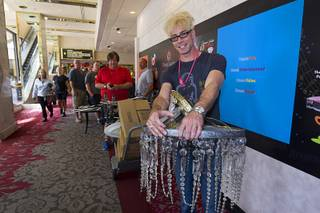 Magician Murray Sawchuck waits to pay for chandeliers from the Frank Sinatra Suite during the first day of a liquidation sale Thursday, May 14, 2015, at the Riviera. Sawchuck performs at Planet Hollywood.