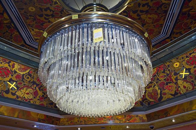 A chandelier ($3,500.00) is shown over the casino floor during the first day of a liquidation sale at the Riviera Thursday, May 14, 2015.
