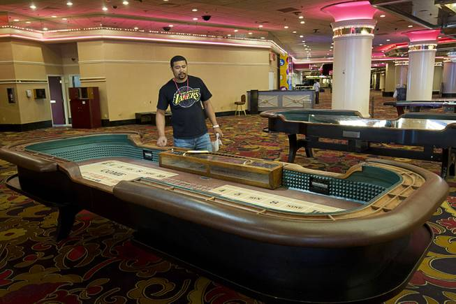 Lamar Hutch of Conyers, Ga. looks over a craps table ($3,850.00) during the first day of a liquidation sale at the Riviera Thursday, May 14, 2015.