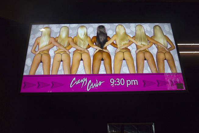 "An illuminated ""Crazy Girls"" sign ($475) is shown during the first day of a liquidation sale Thursday, May 14, 2015, at the Riviera."