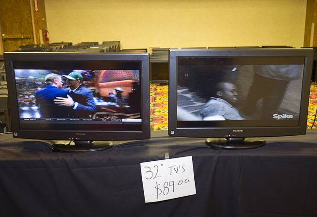 Flat panel televisions ($89.00) are shown during the first day of a liquidation sale at the Riviera Thursday, May 14, 2015.