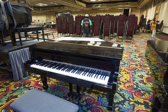 A piano ($5,500.00) is displayed during the first day of a liquidation sale at the Riviera Thursday, May 14, 2015.