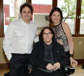 Chef Kerry Simon is flanked by George Maloof and Elizabeth Blau as he celebrates his 60th birthday at Simon on Wednesday, May 14, 2015, in Palms Place.