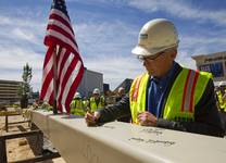 Jeff Ehret, president of Penta Building Group, signs the final steel beam during a topping-off ceremony for the Las Vegas Arena on Wednesday, May 27, 2015, in Las Vegas. Representatives from MGM Resorts International and AEG, contractors Hunt-Penta and elected officials were on hand to celebrate the installation of the arena's final steel beam. The $375 million arena is scheduled to open in Spring 2016.