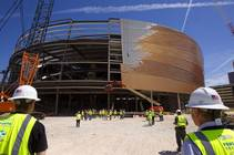 Workers gather around the final steel beam during a topping off ceremony for the Las Vegas Arena on Wednesday, May 27, 2015. Representatives from MGM ...