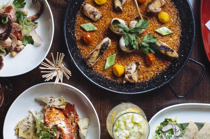Valenciana Paella, Empanadas, Charred Spanish Octopus, and Spicy Garlic Lobster at Tapas by Alex Stratta on May 26, 2015.