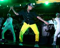 Chris Brown makes a splash as DJ and performer at the grand opening of newly married Victor Drai's Nightsplash Beach Club party as the 35,000-square-foot, sky-high paradise atop the Cromwell transforms into a nighttime oasis.