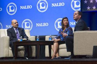 NALEO executive director Arturo Vargas, left, and former state assemblywoman Lucy Flores listen to David Damore, UNLV associate professor, during the National Association of Latino Elected and Appointed Officials (NALEO) 32nd annual conference at Aria Wednesday, June 17, 2015.