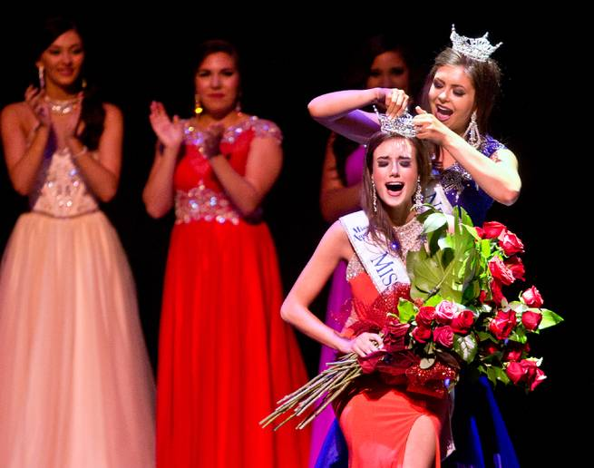 Miss Summerlin Katherine Kelley is crowned the new Miss Nevada by outgoing winner Ellie Smith during the pageant at the Smith Center on Saturday, June 27, 2015.