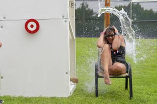 Beth Vandenberg reacts as a bucket of water is dumped on her head during the 67th annual Damboree Celebration in Boulder City, Nev. Saturday, July 4, 2015.